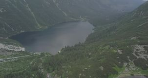 Morskie Oko literally `Sea Eye` or `Eye of the Sea` is the largest and fourth-deepest lake in the Tatra Mountains stock video footage