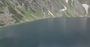 Morskie Oko literally `Sea Eye` or `Eye of the Sea` is the largest and fourth-deepest lake in the Tatra Mountains stock footage