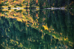 Morskie Oko in the middle of October. Reflections on the Lake in Tatra mountains, very popular among polish and foreign trekkers Royalty Free Stock Images
