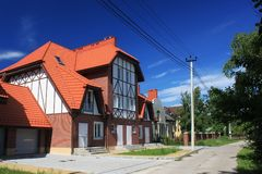 MORSKOE, KALININGRAD REGION, RUSSIA - JUNE 19, 2011: New cottages in the style of half-timbered houses in the Morskoe Pillkoppen Stock Photography