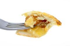 Morso del grafico a torta di mela sulla forcella fotografia stock