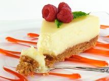 Morso di torta di formaggio Fotografie Stock