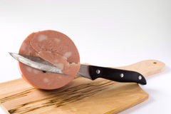 Mortadella And Knife Royalty Free Stock Images
