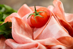 Mortadella slices with red pepper Stock Photography