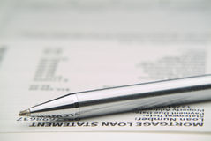 Mortage statement - late payment?. With close-up of pen and mortage statement Stock Image
