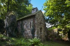 Old church in the forest near Mortain France. stock photos