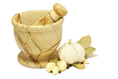 Mortar. And pestle with garlic, pepper and Royalty Free Stock Photography