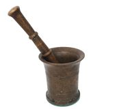 Mortar. Brass mortar and pestle antique alchemy object isolated on white royalty free stock photos