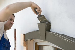 Mortar. Plasterer inflicts mortar on architectural element Royalty Free Stock Photography