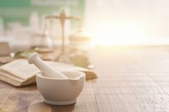 Free Mortar And Pestle On The Pharmacist`s Table Royalty Free Stock Images - 149057169