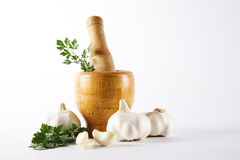 Mortar And Pestle With Garlic And Parsley Stock Photography