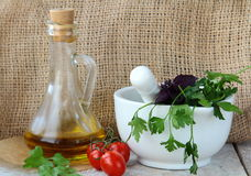 Mortar And Pestle With Herbs Royalty Free Stock Photography