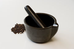 Mortar and black pepper Royalty Free Stock Photos