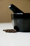 Mortar and black pepper Royalty Free Stock Photography
