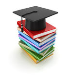 Mortar board and books Stock Photography
