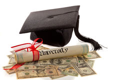 Mortar Board, Diploma, and Currency. Still life of mortar board, diploma, and US currency. Symbol for education costs in America. Horizontal
