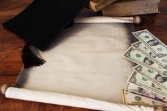 Mortar board and diploma, many dollars Stock Image