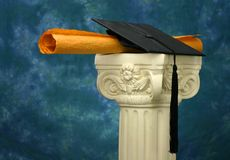 Mortar board and diploma on pedestal - blue Stock Images