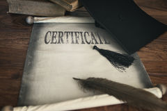 Mortar board and diploma, text certification Stock Photography