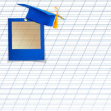 Mortar board or graduation cap. With blue slide on the background notebook sheet Royalty Free Stock Photography