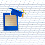 Mortar board or graduation cap with blue slide Royalty Free Stock Photos