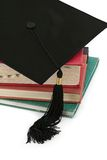 Mortar Board on Old Books Royalty Free Stock Photo