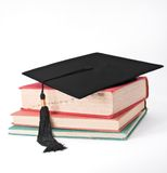 Mortar Board on Old Books Royalty Free Stock Image