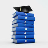 Mortar board on stack of blue  graduate book isolated on white w Royalty Free Stock Image