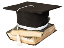 Mortar board on a stack of books. Graduation hat on a pile of old books Stock Photography