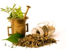 Mortar and bottle, with herbal. Mortar and bottle, with herbs. Herbal tea royalty free stock images