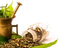 Mortar and bottle, with herbal. Mortar and pharmacy bottle, with herbs. Herbal tea royalty free stock photo