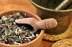 Mortar with bowl with herbs stock photos