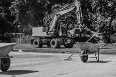 Mortar carts and dredge on a construction site. Photo was taken on a nice sunny day. Time: about noon. Photo was taken on a construction site near football Stock Photography