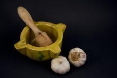 Mortar with garlic. Stock Photos