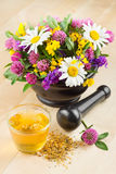 Mortar with healing herbs and flowers,herbal tea Stock Photo