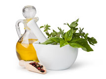 Mortar with herbs isolated Stock Images