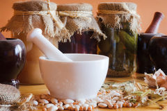 Mortar with herbs in larder Stock Images