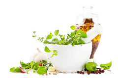 Mortar herbs and oil Stock Photos