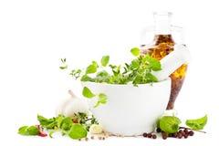 Mortar herbs and oil stock photos