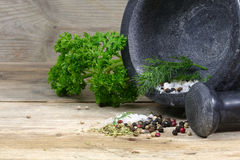 Mortar with herbs and spices on old wood Royalty Free Stock Photos