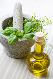 Mortar and herbs, still life. Stock Photography