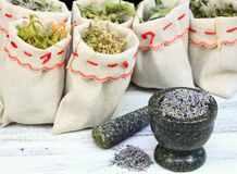 Mortar with lavender and dried medicinal and culinary herbs Royalty Free Stock Photos