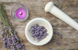 Mortar with lavender flowers on table, top view stock image