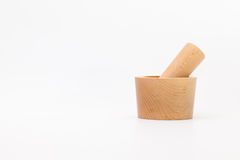Mortar made of tropical wood on white desk Royalty Free Stock Photos