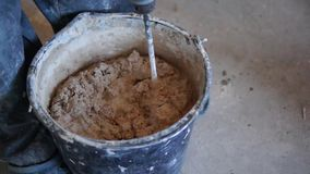 Mortar mixed in bucket stock video
