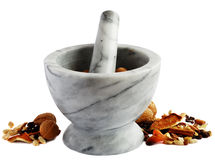Mortar and nuts Royalty Free Stock Photos