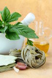 Mortar with pasta  and basil herbs Stock Image