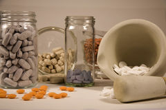 Mortar and Pestle. Pharmaceutical mortar and pestle with various pills and supplements Stock Photos