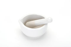 Mortar and pestle. Closeup of white mortar and pestle on studio background with copy space Stock Photos