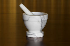 Mortar and pestle. White and black marble mortar and pestle Royalty Free Stock Photos